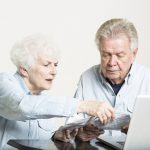 Old_Couple_Doing_Paperwork