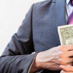 suit_pocketing_money